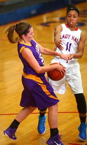 11-14-14 Kokomo vs. Northwestern girls basketball Northwestern's Sydney Zeck and Kokomo's Quaynika Merriweather battle over control of the ball. Kelly Lafferty Gerber | Kokomo Tribune