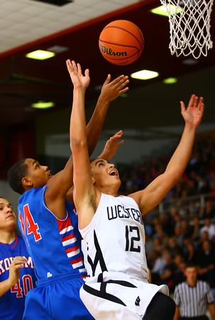11-26-14<br /> Western HS hosting Kokomo HS Boys basketball. Western's Des Balentine tries to rebound his own shot.<br /> Tim Bath | Kokomo Tribune