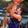 11-29-14<br /> Tri Central vs Northwestern basketball<br /> Northwestern's Derek Doubet jumps to the net.<br /> Kelly Lafferty Gerber | Kokomo Tribune