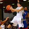 11-26-14<br /> Western HS hosting Kokomo HS Boys basketball. Western's Jack Perkins rebounding a Western shot.<br /> Tim Bath | Kokomo Tribune