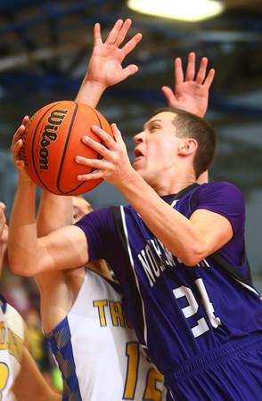 11-29-14<br /> Tri Central vs Northwestern basketball<br /> Northwestern's Blake Oakley tries to make a shot past Tri Central's defense.<br /> Kelly Lafferty Gerber | Kokomo Tribune