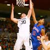 11-26-14<br /> Western HS hosting Kokomo HS Boys basketball. Western's Zach Shahan up for a shot with Jordan Matthews unable to stop him.<br /> Tim Bath | Kokomo Tribune