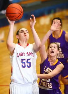 11-14-14 Kokomo vs. Northwestern girls basketball Kokomo's Sieara Langley shoots as Northwestern's Sarah Vas tries to stop her. Kelly Lafferty Gerber | Kokomo Tribune