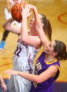 11-14-14 Kokomo vs. Northwestern girls basketball Kokomo's Emily Bailey gets fouled by Northwestern's Sydney Zeck as Bailey goes up for a shot. Kelly Lafferty Gerber | Kokomo Tribune
