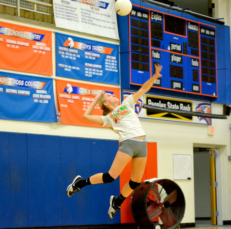 Newton's Taylor Johnson skies for a serve attempt during an intrasquad scrimmage before the Class 2A Flora Sectional.