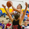 Newton's Brock Mammoser drives over a Chrisman player at the Cumberland Thanksgiving Tournament.