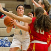 Cumberland's Zoe Marti eyes the basket while Charleston's Hope Griffin and Paige Swango team up on defense at Cumberland High School.<br /> Keith Stewart photo