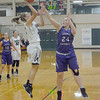 Erin Patterson shoots over Guerin Catholic's Maggie Stordy in the first quarter Saturday night.