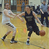 Zionsville's Rachel McLimore dribbles past Haley Nichols on Friday.