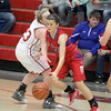 Olivia Hole drives past Reagan Case in the fourth quarter on Saturday.