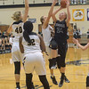 Maddie Nolan shoots a runner amongst three Avon defenders on Friday, Nov. 18.