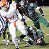 Scott Rodgers (21) and Zach Watkins bring down Columbus East's Cameron Wilson on Friday.