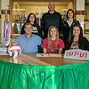 Windsor/Stew-Stras' Becca Schlechte, center, signed her letter of intent to play volleyball at Indiana University-Purdue University of Indianapolis. Pictured in the front row, from left to right are Bob Schlechte, Becca Schlechte and Ronda Schlechte. Back row, from left: Rapid Fire club volleyball coach Lisa Peifer, Stewardson-Strasburg athletic director Shane Smith and assistant coach Tammy Manhart.