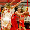 Altamont's Shelbi Stone, right, tries to pass around Charleston's Paige Swango (24).