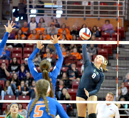 Windsor/Stew-Stras' Mackenzi Tabbert (8) goes for a kill around several Lanark Eastland defenders at the Class 1A state semifinals at Redbird Arena in Normal.