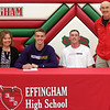 Effingham's Jacob Donaldson, center, signed official paperwork, committing to play basketball at McKendree University next fall. Pictured, left to right, are Missy Donaldson, Jacob Donaldson, David Donaldson and Effingham boys basketball coach Ron Reed.