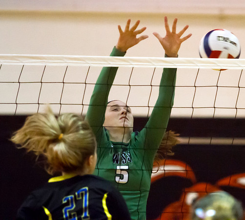 Windsor/Stew-Stras' Kasey Bean jumps in defense of an incoming spike from a Danville Schlarman player during the Class 1A Fisher Sectional.