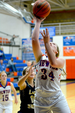 Newton's Grace Hartrich goes for a layup against Teutopolis.