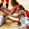 Effingham's Carsyn Fearday,  right, and Altamont's Tinley Mette, middle, vie for the ball at the Bob Kerans' Thanskgiving Tournament in Newton. The Lady Indians' 27 turnovers were too many as they instead fell 64-36.