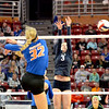 Windsor/Stew-Stras' Maria Gentry (3) jumps and tries to block a ball hit by Lanark Eastland's Makenzie Fink (32, foreground) during the Class 1A state semifinals at Redbird Arena in Normal. The Hatchets fell in three sets.