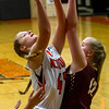 Altamont's Leah Mayhaus, left, goes back up for the basket over Dieterich's Cassie Vahling after pulling down the offensive rebound. Mayhaus led the Lady Indians with 18 points and nine rebounds in their 61-31 Homecoming win.
