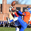Newton's Joe Stone (15, right) battles in the air for a pass with Carlinville defensive back Josh Hinzman (left) during the Class 3A state football quarterfinals at Newton.