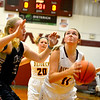 Dieterich's Anna Shadle grabs an offensive board and looks to put up a shot against the defense of Centralia Christ Our Rock Lutheran's Caroline Boehne Thursday