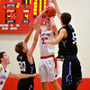 St. Anthony's Drew Gibson shoots over the defense of Breese Central's Simon Thomas (30) and Tyler Joest (55) at the St. Anthony Thanksgiving Tournament.