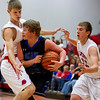 St. Anthony's Wyatt Lawrence, left, and Drew Gibson, right, double team Okaw Valley's Sam Hagerman during the season opener at home, kicking off the Thanksgiving Tournament. The Bulldogs' defense set the tone off the bat as they went on to win 75-24.