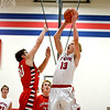 St. Anthony's Alex Deters takes a layup to the rim as Effingham's Brent Beals defends.