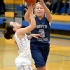 South Central's Abby Hahn throws a pass over the defense of CHBC's Erica Lorton at Cowden-Herrick. Hahn set South Central's career scoring record in the loss, scoring 26 points.