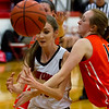 North Clay's Darcy Fender, left, draws a foul from Olney's McKenzie Mowrer, who later fouled out.