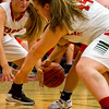 Effingham's Aly Armstrong, left, and Shelby Myers, right, scramble for a loose ball during a game against Pana, which the Hearts won 46-32.