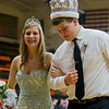 Altamont homecoming queen Keidron Duckwitz, left, and king Joe Stone, right, exit the Altamont High School gymnasium ahead of the girls' varsity basketball game, which marked the first time a female sporting event commemorated Homecoming in school history.