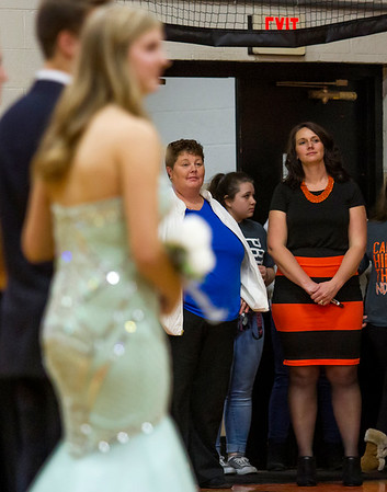 Altamont head coach Katie Lurkins, right, and Dieterich head coach Donetta Ohnesorge, center, watch in anticipation during the coronation ceremony. The Lady Indians' Keidron Duckwitz, left, was crowned homecoming queen and soon after played in the girls' home opener in Altamont, which they won 61-31. The game marked a first in school history in which a girls' sporting event marked Homecoming.