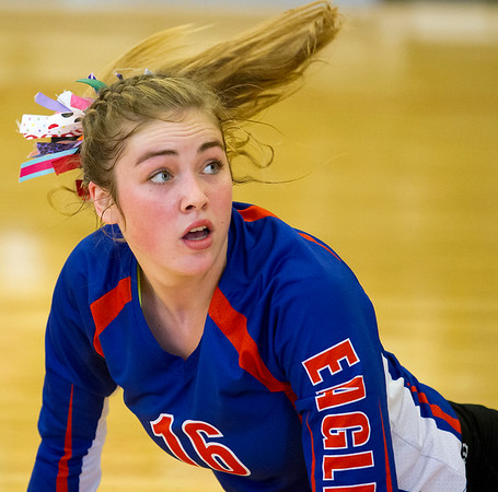 Newton outside hitter Kaitlyn Cohorst watches as the ball gets past her dig attempt and strikes the back right corner for the match-winner during the Class 2A Trenton Super-Sectional against Belleville Althoff Catholic, who won 25-15, 25-16.