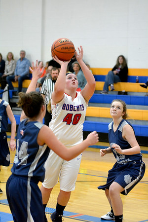 CHBC's Lauren Wojick goes for a short jump shot between two South Central defenders.