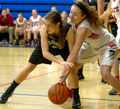 Cumberland's Skylar Brumleve, left, and Effingham's Natalie Carie, right, reach for a loose ball during the final game at the Bob Kerans Thanskgiving Tournament in Newton.