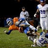 Newton's Trenton Duncan is tackled by Carlinville's Jake Ambuel during Newton's Class 3A state quarterfinal loss in Newton.