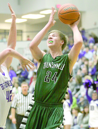 Zionsville sophomore Derrik Smits pulls up for a shot during the 1st quarter of Friday night's game at Brownsburg.