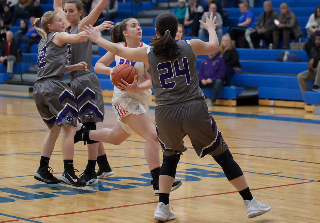 . Haley Andrejcak keeps her eyes on the goal, driving down the middle of the key. Jen Forbus -- the Morning Journal