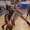 Keystone's Petyon Halleen drives with determination around Bay's Maeve Johnston. Jen Forbus -- The Morning Journal