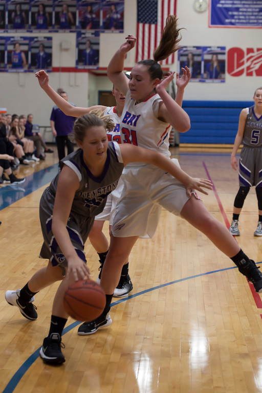 . Keystone\'s Petyon Halleen drives with determination around Bay\'s Maeve Johnston. Jen Forbus -- The Morning Journal