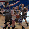 Surrounded by Wildcats, Bay's Halle Orr looks for an opportunity to sink a basket. Jen Forbus -- The Morning Journal
