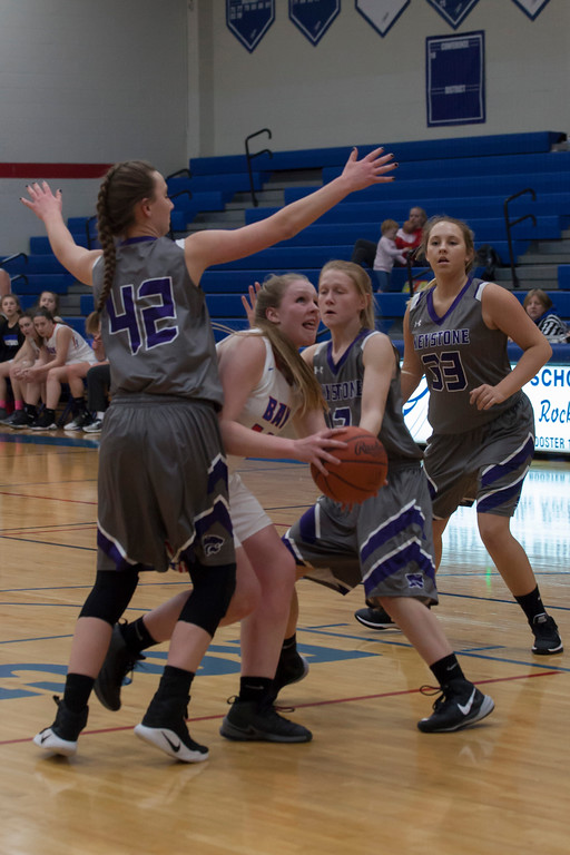. Surrounded by Wildcats, Bay\'s Halle Orr looks for an opportunity to sink a basket. Jen Forbus -- The Morning Journal