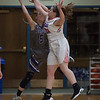 Keystone's Haley Sprouse and Bay's Haley Andrejcak vie for the basketball mid-flight. Jen Forbus -- The Morning Journal