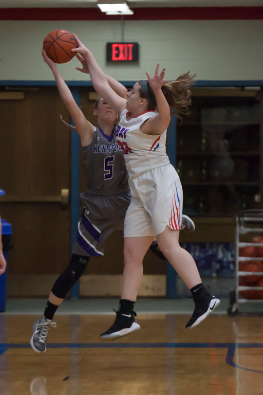 . Keystone\'s Haley Sprouse and Bay\'s Haley Andrejcak vie for the basketball mid-flight. Jen Forbus -- The Morning Journal
