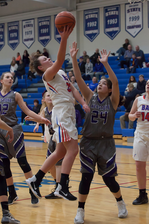 . Bay\'s Maeve Johnston takes the ball to the hoop. Jen Forbus -- The Morning Journal