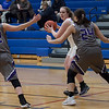 With Wildcats all around, Rocket Halle Orr looks for help from her team. Jen Forbus -- The Morning Journal