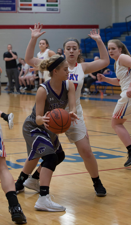 . Bay\'s Haley Andrejcak puts up some defensive pressure in the back court after Keystone\'s Shelby Fortune grabs a rebound. Jen Forbus -- The Morning Journal